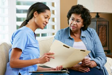image of a woman talking with a healthcare professional