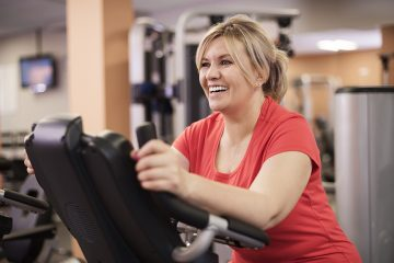 image of woman exercising on an elliptical